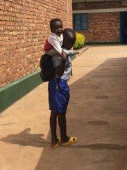Rwanda piggy back Qm0Mc8t_FOyJQP9IEoIC4CJRX6V72g7bn_s7LNgX5a8pX92IB